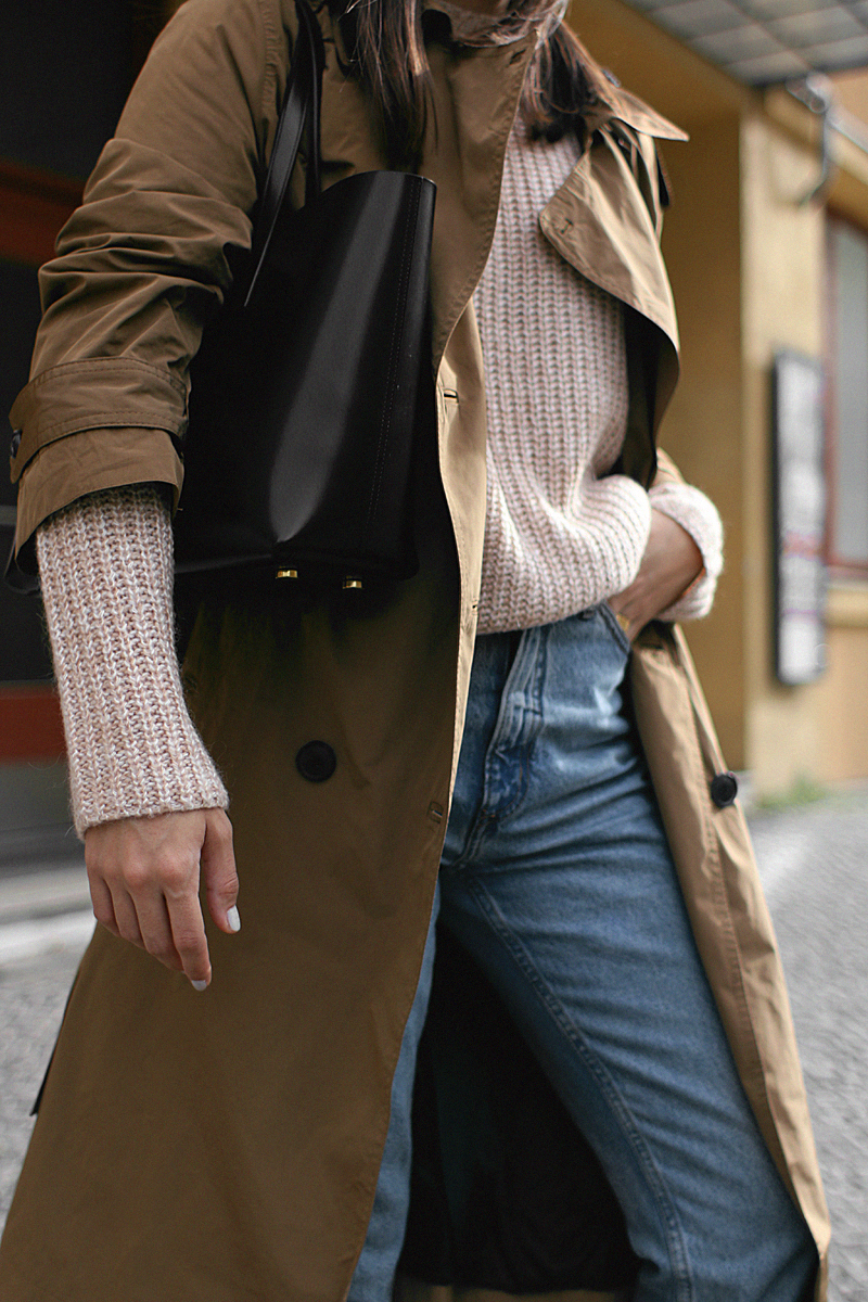 Nisi is wearing: Trench coat, Gucci Princetown Slipper, mom jeans, blush-toned knit, Saint Laurent Shopper