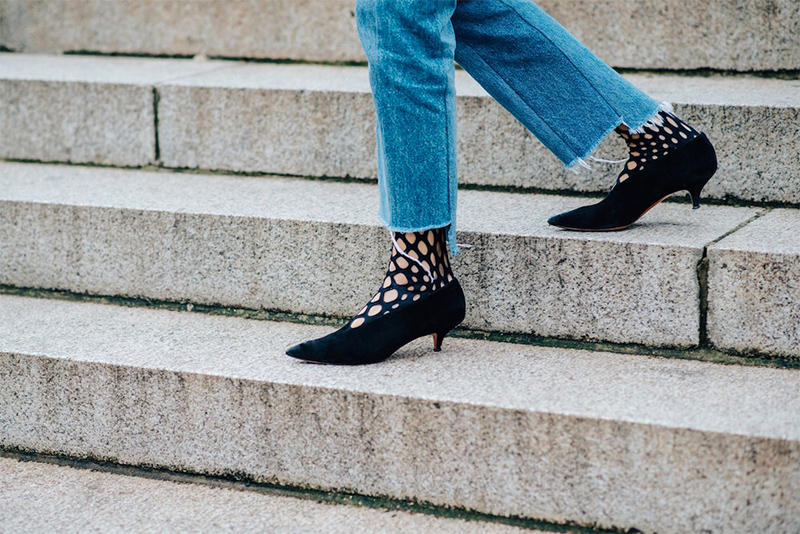 Fishnet Tights - Trend alert! Worn with pointed black pumps and denim jeans