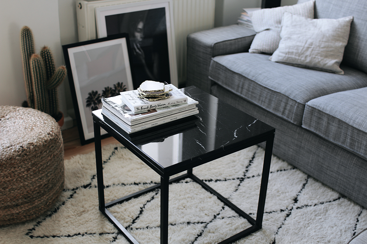 Interior Inspiration - The living room. Beni Ourain rug and black marble table