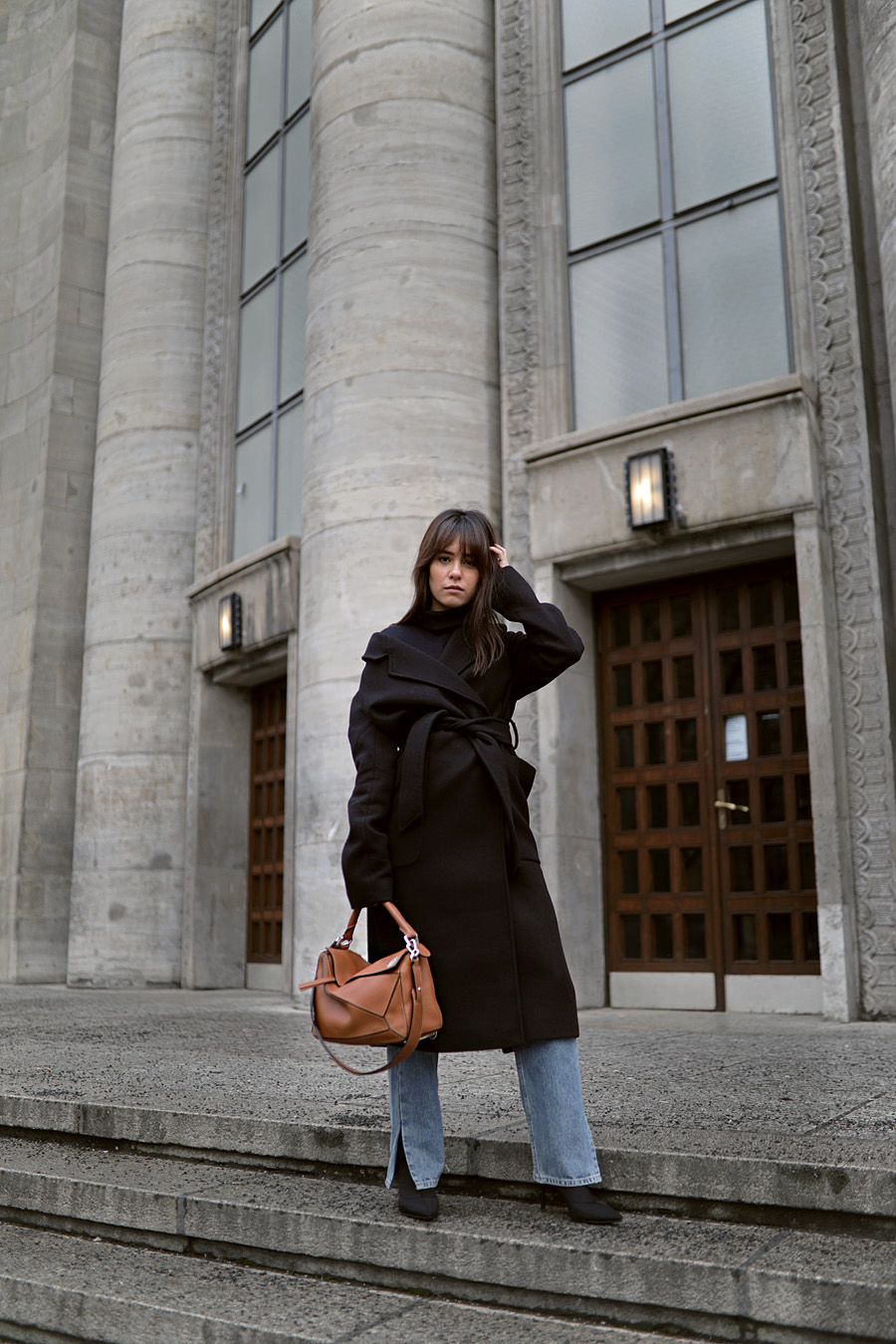 Outfit: Wrap coat and long straight denim. Nisi is wearing: Belted wrap coat, Navy Turtleneck, straight denim jeans, Sock boots, Loewe Puzzle bag