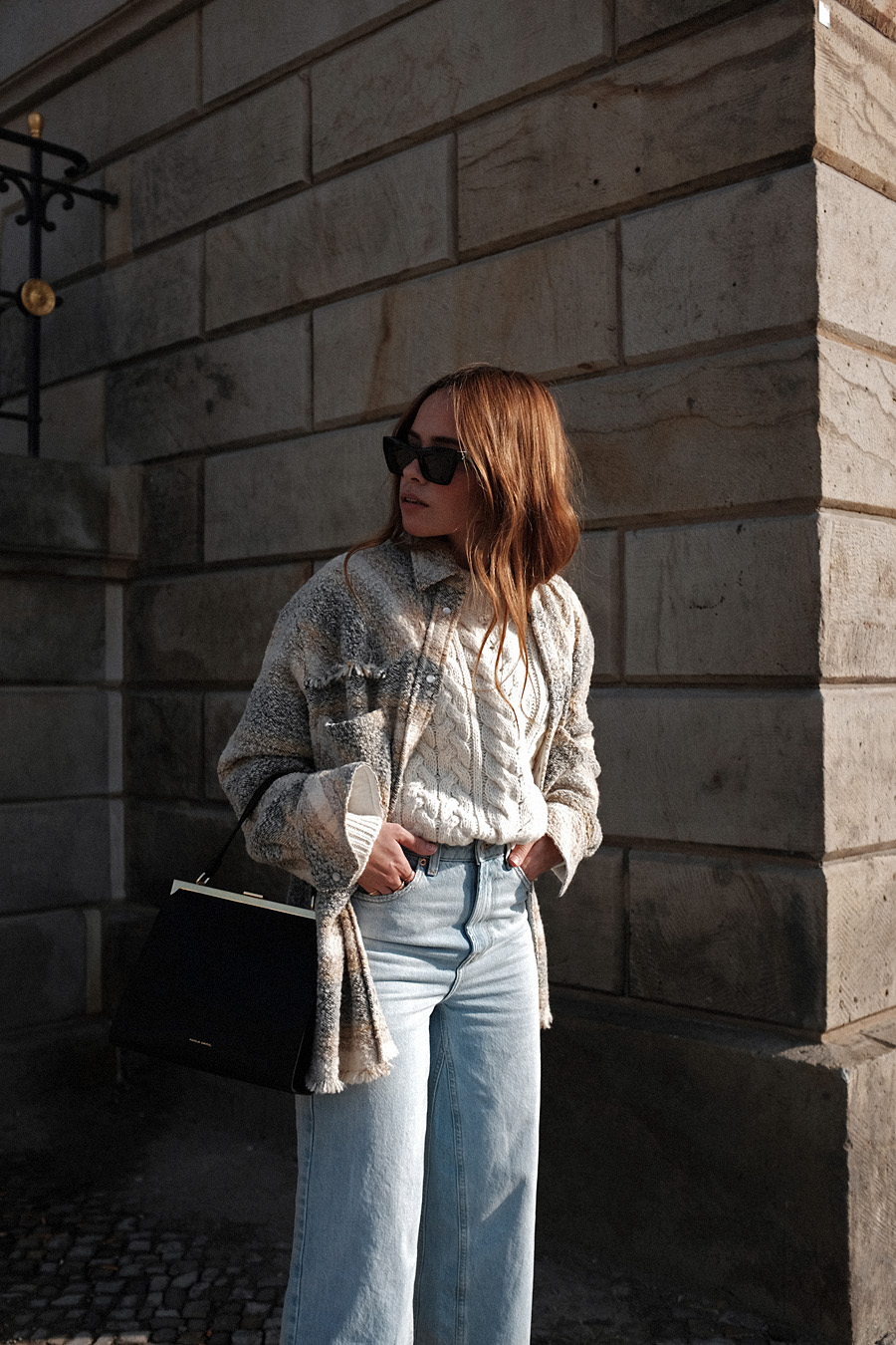 Outfit: Cable Knit and Cropped Flared Denim. Desi is wearing: Céline Madame Boots, Céline Eva sunglasses, Mansur Gavriel Elegant bag, Cropped flared denim jeans, checked wool-blend bouclé shirt, cable knit jumper