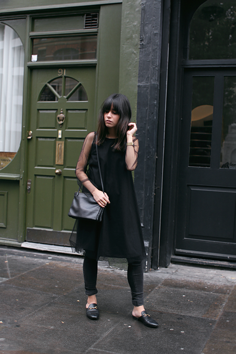 Nisi is wearing: Céline Trio Bag, Gucci Princetown slipper, black mesh dress, skinny jeans