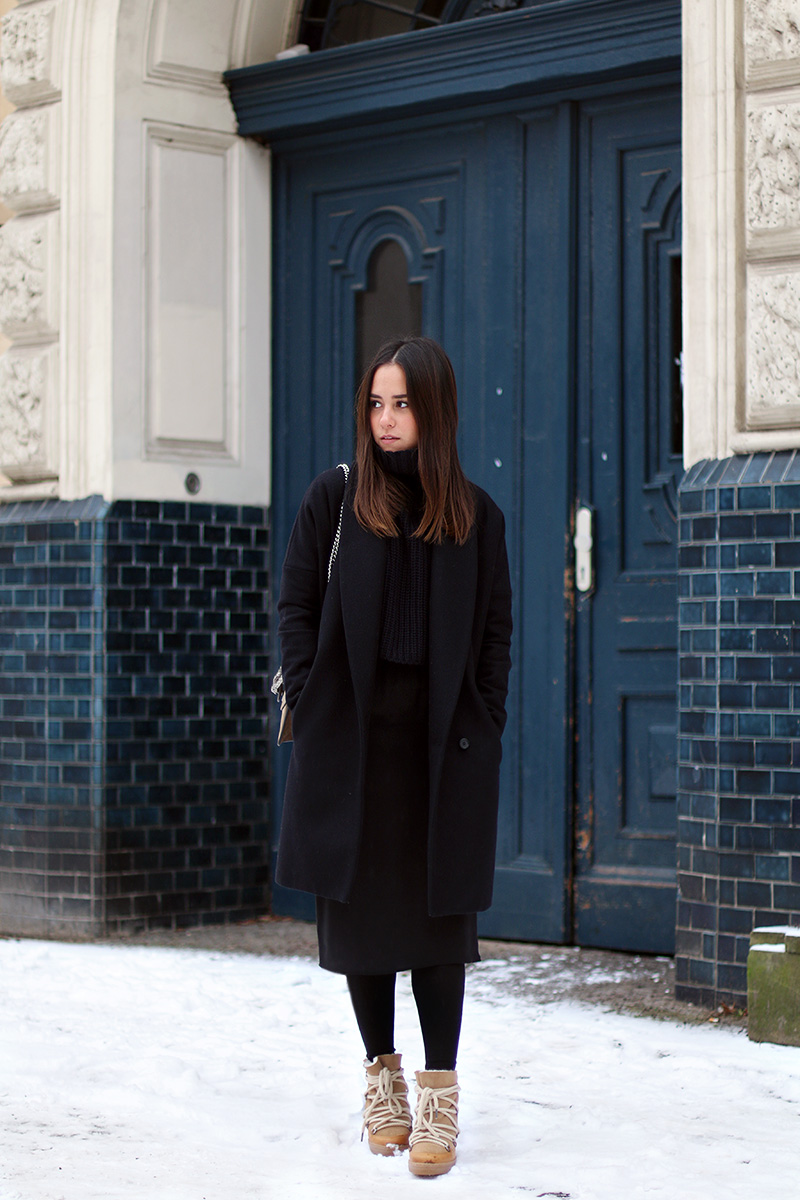Nisi is wearing: Gucci Dionysus Bag, Isabel Marant Nowles Boots, Midi silk dress, wool coat and cropped turtleneck sweater