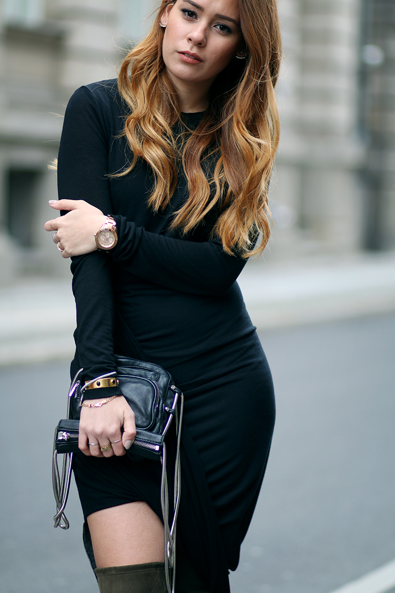 How to style overknees: Desi is wearing Stuart Weitzman Overknees, asymmetric draped dress and Alexander Wang Brenda Camera Bag