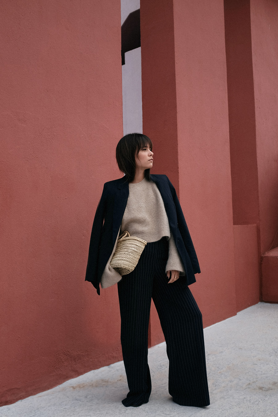 Outfit: Suit up. Blazer, Pin-striped trousers, Bellsleeves Sweater, Straw bag