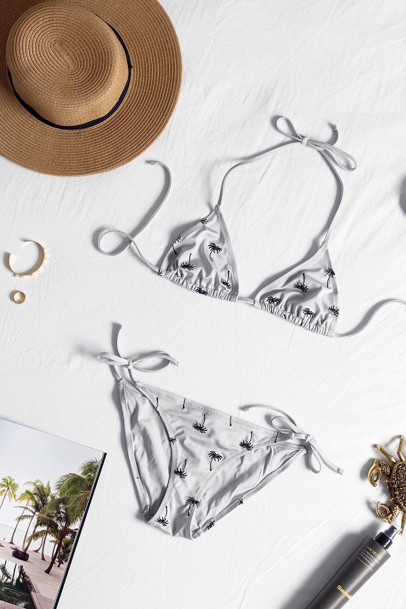 triangle bikini, palm trees, urban outfitters, céline sunglasses, bikini flat lay, Nina Kastens jewellery