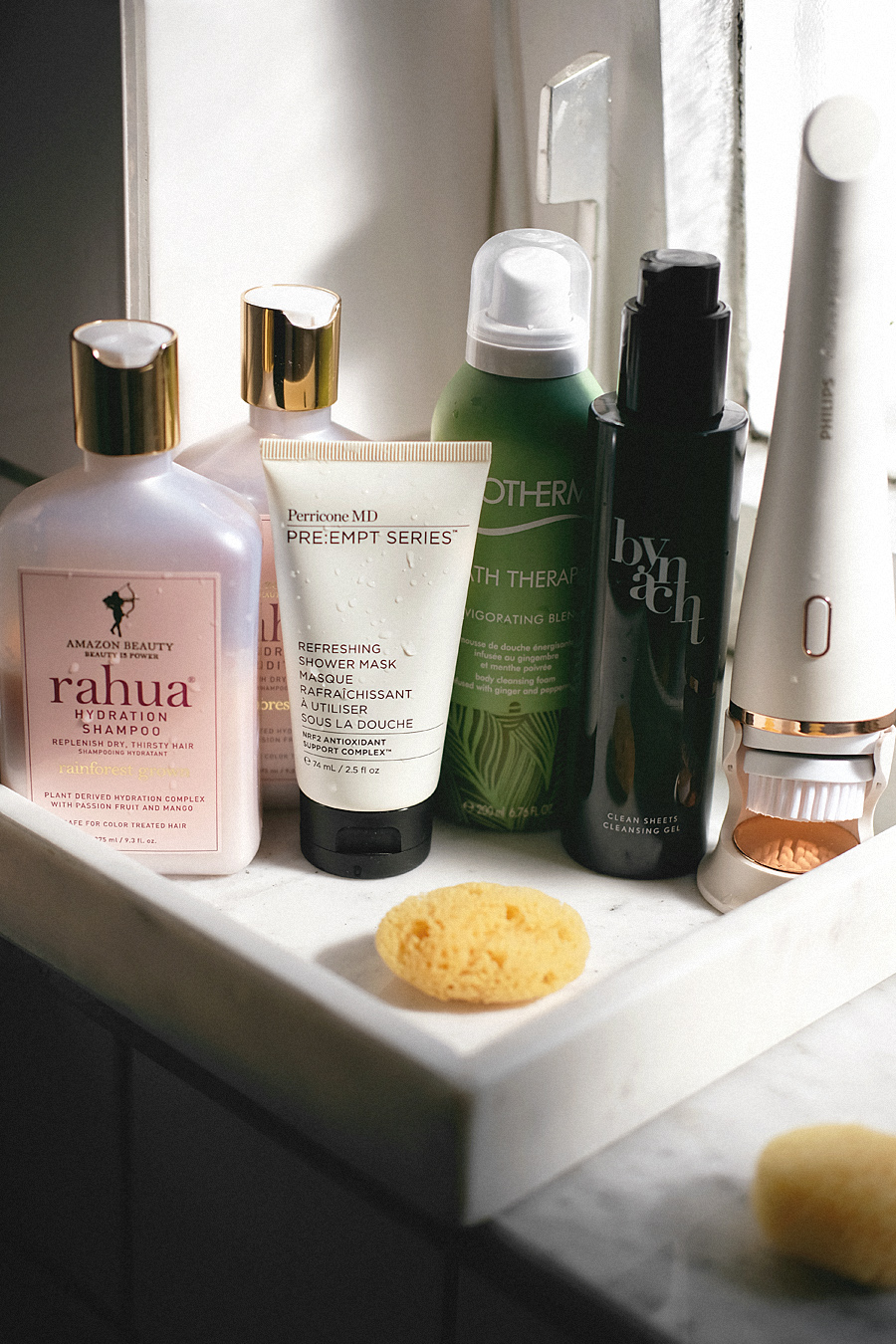 What's in my Shower - Bathroom Beauty Products: Rahua Hydration shampoo & conditioner, Perricone MD Refreshing shower mask, Biotherm, Bath Therapy Invigorating shower foam, Clean Sheets Cleansing gel Bynacht, Philips VisaPure, Cowshed Wild Cow Bath and massage oil, Diptyque candles, TANGENT GC Oud Organic soap