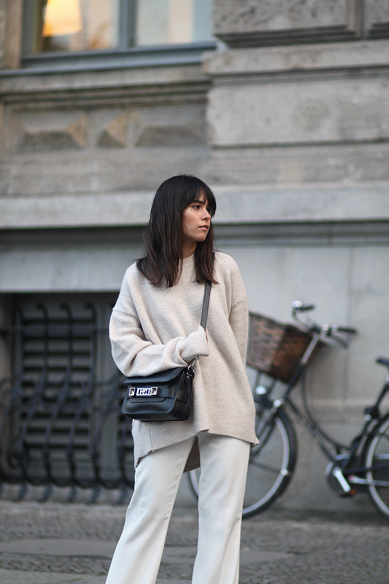 Outfit - Wide and comfy. Nisi is wearing: White wide-leg pants, oversized knit sweater, Proenza Schouler PS11 Mini Classic Bag, Hermès Oran sandals