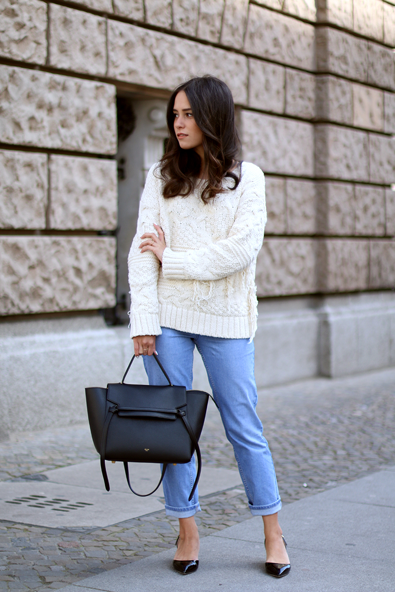 Nisi is wearing. Fringed Sweater, Girlfriend Jeans, Jimmy Choo sling-back pumps and Céline Belt bag